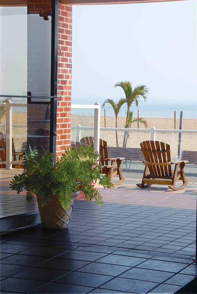 The Plim Plaza Hotel featurs a large from porch filled with rocking chairs overlooking the Ocean City beach and Atlantic Ocean