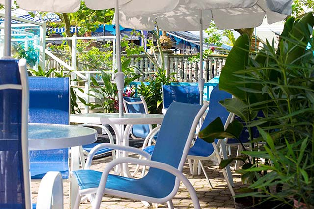 Relax poolside and enjoy a bite to eat from the Caribbean Pool Bar