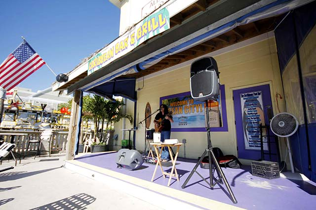 Live local music every day during the summer at the Caribbean Pool Bar and Grill