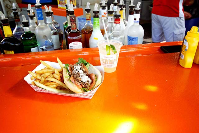 Grab some quality food by the pool, and just steps from the ocean, at the Caribbean Pool Bar and Grill