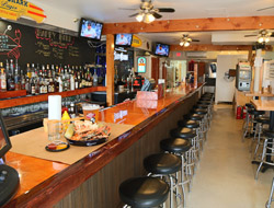 Mug and Mallet bar with stools and televisions.